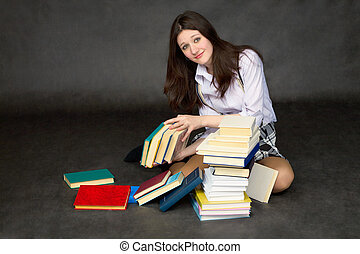 Schoolgirl with the big heap of books