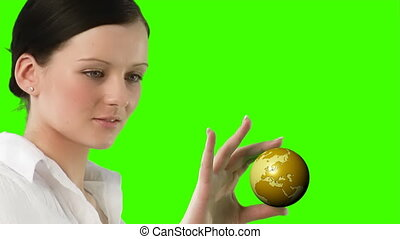 Green Screen of a woman holding a Globe - Chromakey of a...