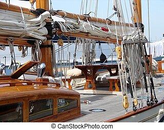 sailboat at rest - sailboat moored at the marina