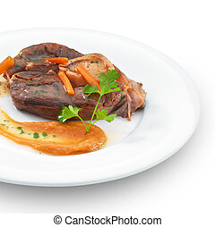 Traditional italian osso buco meat. Isolated on white -...