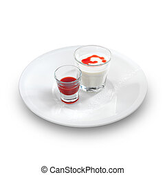 Smooth and creamy panna cotta with strawberry and raspberry sauce in a small glass isolated on white.