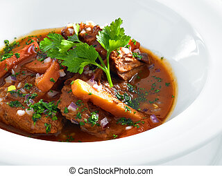 Rich hot hungarian beef goulash with traditional topping...