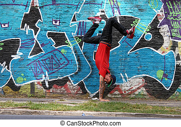 Breakdance - A performing HipHop Dancer in front of a...