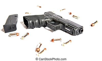 Gun Pistol - A pistol lays ready for use by an individual...