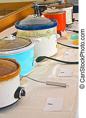 crock pots for chili cook-off - Row of crock pots for chili...