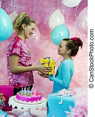 Girl Gives Gift to Birthday Girl