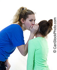 Girls Telling Secrets - Two girls whispering and telling...