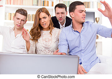 young frustrated casual group of friends sitting on couch...