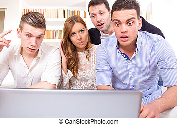 shocked and frustrated casual group of friends sitting on...