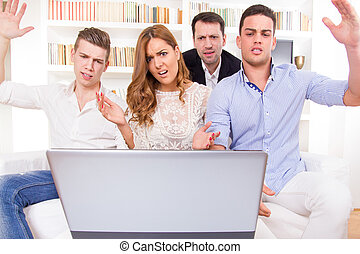 frustrated and shocked casual group of friends sitting on...