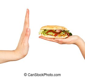 Say No to Unhealthy Food! - Female hand rejecting the...