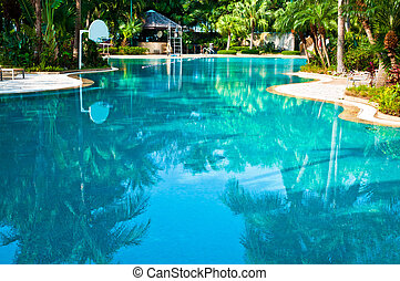 Curved swimmingp ool - Curved swimming pool in a tropical...