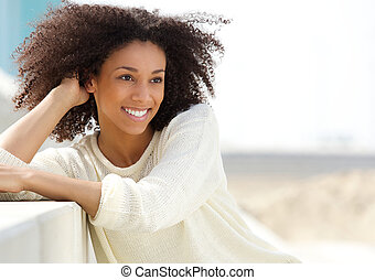 African american woman relaxing outdoors - Close up portrait...