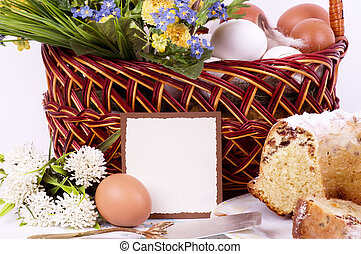 Traditional Easter cake with Easter eggs and spring flowers