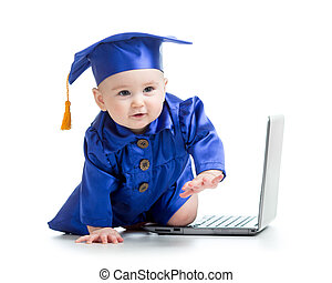happy child in academician clothes  with laptop