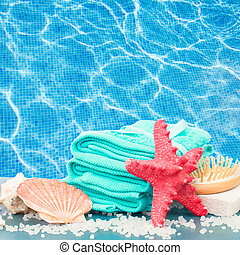Sea spa setting by pool side - Sea spa treatment setting...