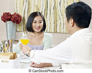 asian couple - husband and wife toasting