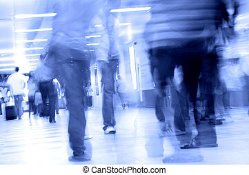 people walking in subway - motion blurred of people walking...