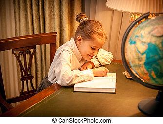 Little girl doing geography homework
