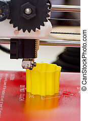 Three dimensional printer in action - Detail of 3D printer...