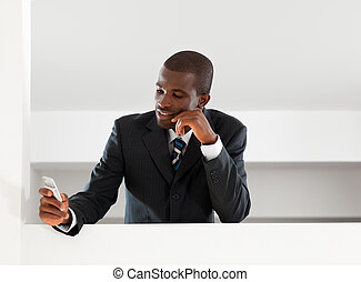 businessman reading emails - young adult afro-american...