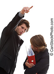 Fired employee - Angry employer firing his employee, holding...