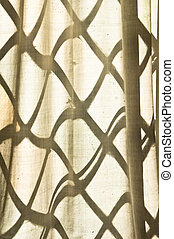 Lattice window - Pattern from a lattice window on a thin...