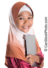 Young Muslim Girl With Laptop - Young Asian Muslim girl with...