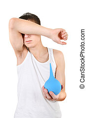 Teenager with Enema Isolated on the White Background