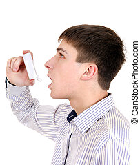 Teenager with Inhaler - Teenager using Inhaler Isolated on...