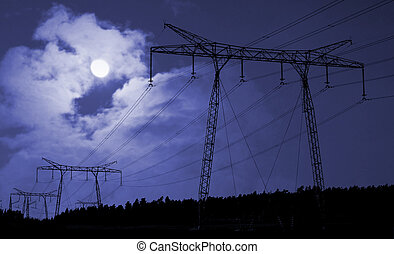 Electricity supply cables in countryside at night