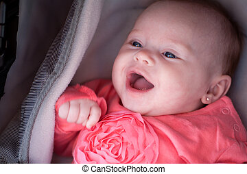Smiling baby in the pram - Happy baby is smiling in her pram
