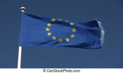 The European Union flag blowing in the wind.