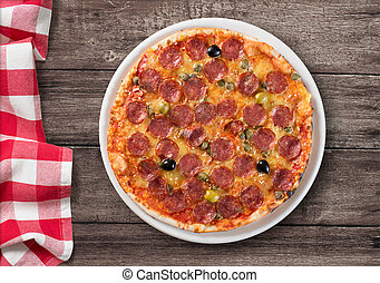pizza with salami top view on wooden table with picnic...