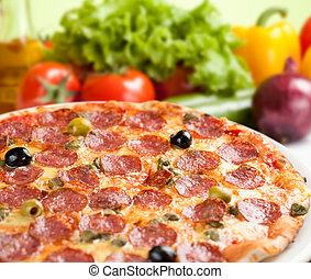 Italian salami pizza with vegetables