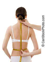 Measuring woman\'s back length, with centimetre isolated, in...