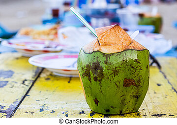 Coconut water drink - Coconut water drink on table at beach...