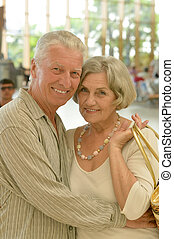 couple at shopping mall - Cute happy senior couple at...