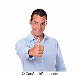 Handsome latin man with positive thumb sign - Portrait of a...