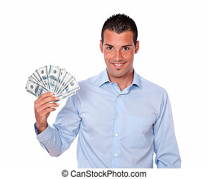 Handsome young guy holding his dollars