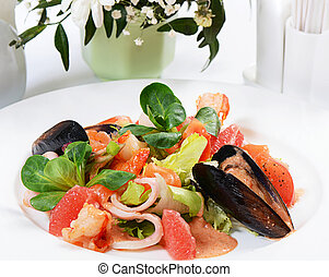 Salad from seafood and a salmon close-up
