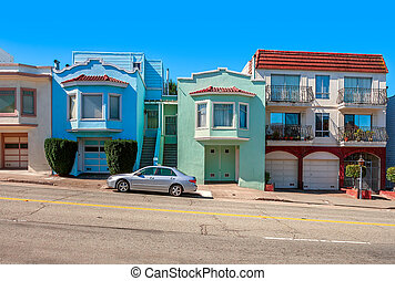 Colorful houses on sloping street in San Francisco. -...