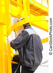 welding on ladder - Atmosphere in the construction and...
