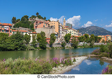 Shallow stream and old town of Ventimiglia, Italy - Shallow...