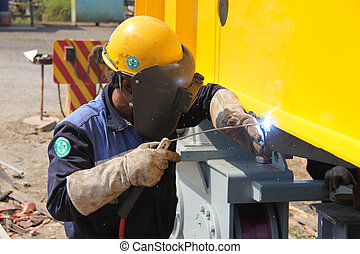 welding yellow crane - Atmosphere in the construction and...