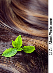 Hair care concept: beautiful healthy shiny hair with...