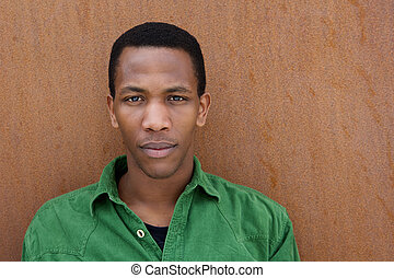 Black man with serious expression - Close up portrait of a...