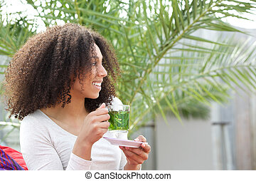 African american woman drinking tea - Close up portrait of a...