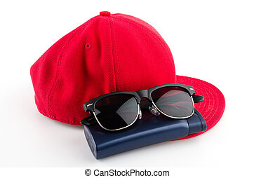 Red cap , sunglasses , lotion isolated white background