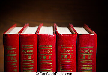 red books against brown background